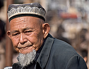 Uyghur man at the livestock market, Kashgar, China